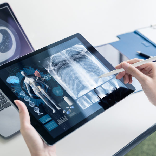 Doctor reviewing medical images on a tablet computer